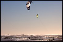 Kite surfers and Pacific Ocean waves, late afternoon. San Francisco, California, USA