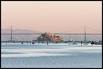 Alcatraz Island and Bay Bridge, sunset. San Francisco, California, USA (color)