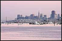 Alcatraz Island and Bay Bridge, painted in pink hues at sunset. San Francisco, California, USA