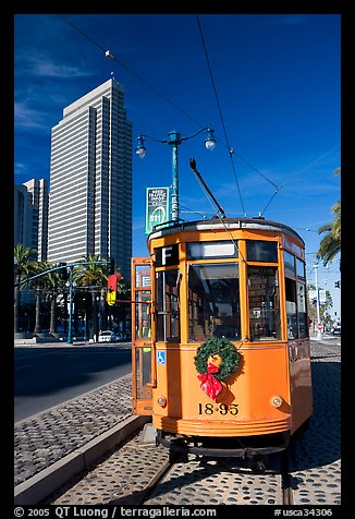 Historic trolley car and Embarcadero center building. San Francisco, California, USA
