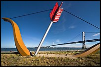Modern sculputure called Cupid's arrow, framing the Bay Bridge. San Francisco, California, USA (color)