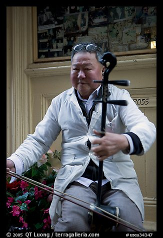 Chinese man playing the traditional Ehru, Chinatown. San Francisco, California, USA (color)