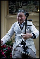 Chinese man playing the traditional Ehru, Chinatown. San Francisco, California, USA ( color)