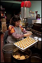 Woman folding fortune cookies, Chinatown. San Francisco, California, USA ( color)