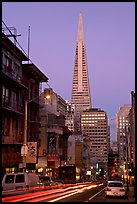 Chinatown street and Transamerica Pyramid, dusk. San Francisco, California, USA