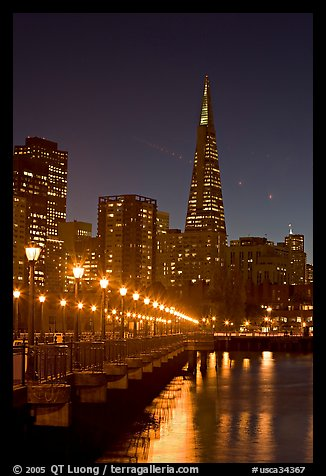 Transamerica Pyramid and Pier seven reflections at night. San Francisco, California, USA (color)