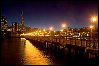 Skyline, Pier 7 lights and reflections at night. San Francisco, California, USA