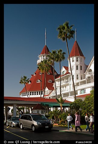 Entrance of hotel del Coronado, with cars and visitors wolking. San Diego, California, USA (color)