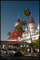 Entrance of hotel del Coronado, with cars and tourists walking. San Diego, California, USA ( color)