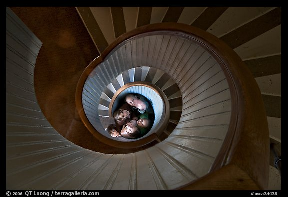 Children standing at the bottom of stairwell, Point Loma Lighthous. San Diego, California, USA (color)
