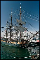 Maritime Museum with HMS Surprise and ferryboat Berkeley. San Diego, California, USA (color)