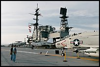 Couple looking at fighter aircraft on the Flight deck of USS Midway. San Diego, California, USA ( color)
