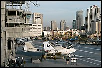 Flight control tower, aircraft, San Diego skyline, USS Midway aircraft carrier. San Diego, California, USA (color)