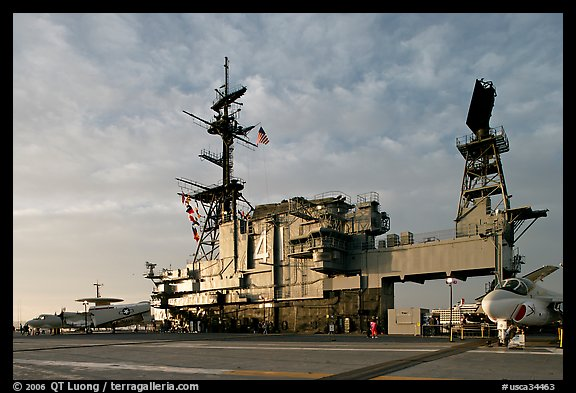 Flight deck and island, USS Midway aircraft carrier, late afternoon. San Diego, California, USA (color)