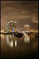 Yachts and skyline from Harbor Drive, at night. San Diego, California, USA
