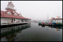 Period and modern boathouses in fog, Coronado. San Diego, California, USA