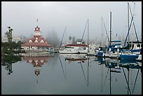Boats and historic Coronado boathouse in fog. San Diego, California, USA