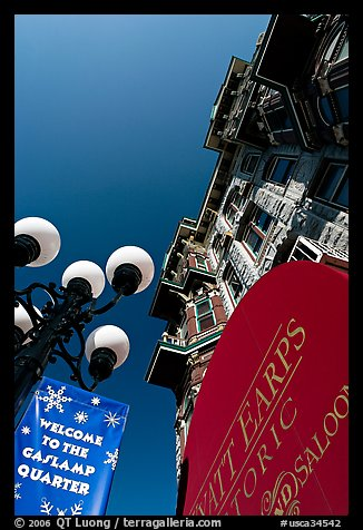 Gaslamp, signs, and facade of the Louis Bank of Commerce, Gaslamp quarter. San Diego, California, USA (color)