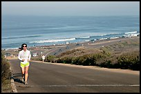 Woman jogging on raod,  Torrey Pines State Preserve. La Jolla, San Diego, California, USA (color)