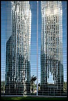 Bell tower reflected in Crystal Cathedral Facade. Garden Grove, Orange County, California, USA