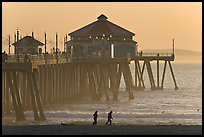 Beachgoers and Huntington Pier, late afternoon. Huntington Beach, Orange County, California, USA