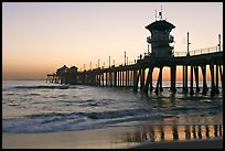 The 1853 ft Huntington Pier reflected in wet sand at sunset. Huntington Beach, Orange County, California, USA ( color)