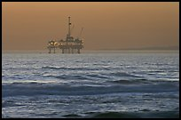 Off-shore petrol extraction  platforms, sunset. Huntington Beach, Orange County, California, USA