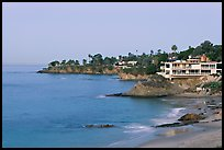 Rocky coastline with waterfront houses at dawn. Laguna Beach, Orange County, California, USA