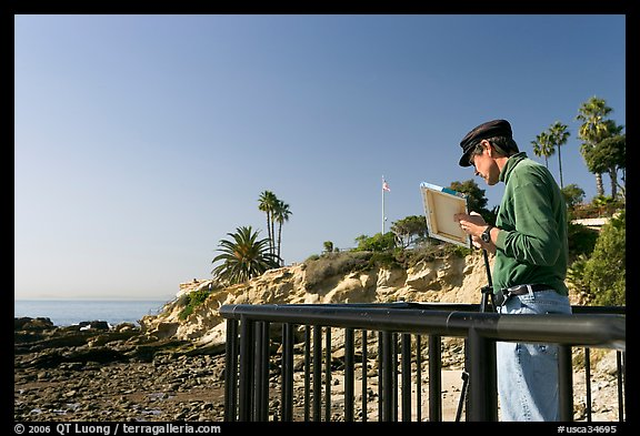 Painter working from an overlook. Laguna Beach, Orange County, California, USA (color)
