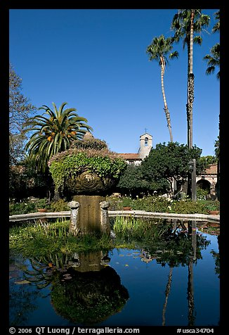 Palm trees reflected in central  courtyard basin. San Juan Capistrano, Orange County, California, USA (color)