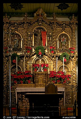 350 year old retablo made of hand-carved wood with a gold leaf overlay. San Juan Capistrano, Orange County, California, USA (color)