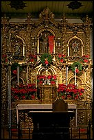 350 year old retablo made of hand-carved wood with a gold leaf overlay. San Juan Capistrano, Orange County, California, USA
