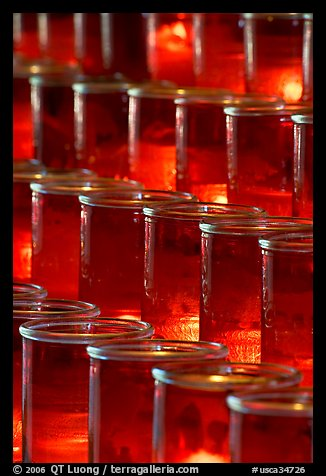 Red candles in glass, sharp. San Juan Capistrano, Orange County, California, USA (color)