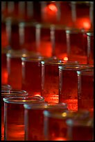 Candles in red glass, background blurred. San Juan Capistrano, Orange County, California, USA (color)