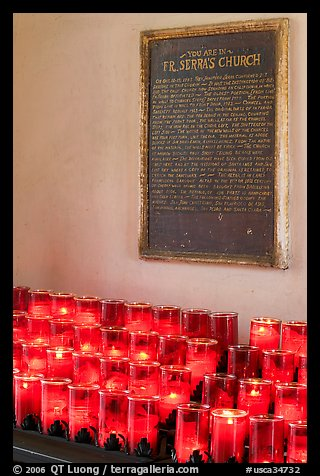 Rows of candles and sign commemorating Father Serra. San Juan Capistrano, Orange County, California, USA (color)