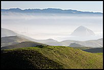 Power plant and Morro Rock seen from hills. California, USA
