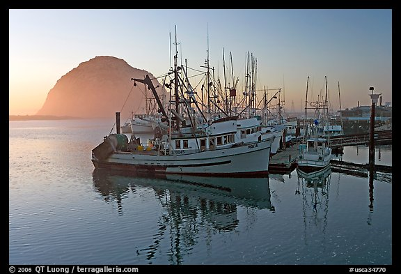 Fishing fleet and Morro Rock, sunset. Morro Bay, USA
