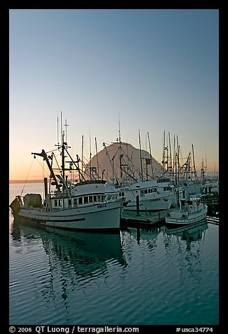 Fishing boats and Morro Rock, sunset. Morro Bay, USA (color)