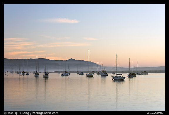 Yachts in calm Morro Bay harbor, sunset. Morro Bay, USA