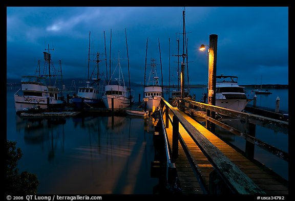 Deck and boats at night. Morro Bay, USA (color)