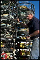 Man loading crab traps. Morro Bay, USA (color)