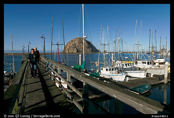 People walking on a deck in the harbor. Morro Bay, USA (color)