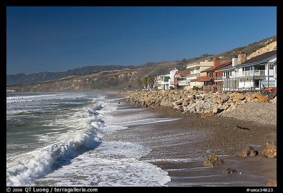 Surf and beachfront houses near Rincon Island. California, USA (color)