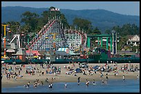 Beachgoers, and Santa Cruz boardwalk roller-coaster. Santa Cruz, California, USA (color)