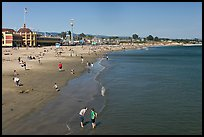 Beach with couple standing in water. Santa Cruz, California, USA