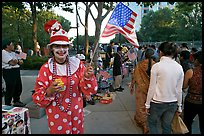 Woman in clown costume waiving American Flag, Independence Day. San Jose, California, USA (color)