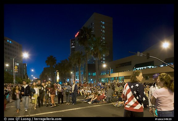 Families waiting for fireworks on Almaden street, Independence Day. San Jose, California, USA (color)