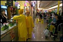 Buddhist nuns in the foot court of the Grand Century mall. San Jose, California, USA
