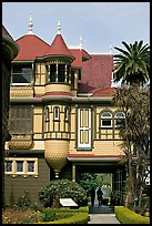 Mansion wing with door opening to a one-story drop. Winchester Mystery House, San Jose, California, USA