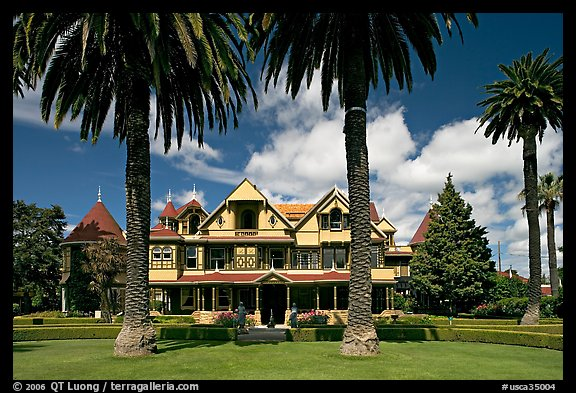 Palm trees and mansion facade. Winchester Mystery House, San Jose, California, USA (color)